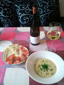 "Chanterelle Soup and salt-cured salmon with Finnish flat bread ""rieska"" made of barley."